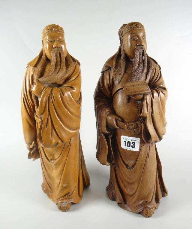 Carved scholars