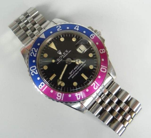 Rolex GMT Fuchsia Wristwatch Sold 13000